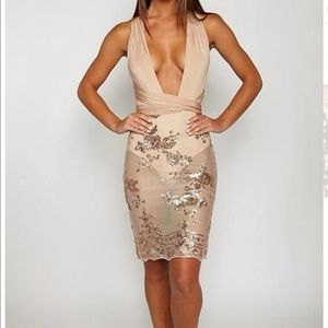 Shakira Gold Wrap Dress New but without the Tags.